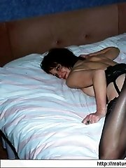 Hot mature dame in black stockings shows intim parts of hot body